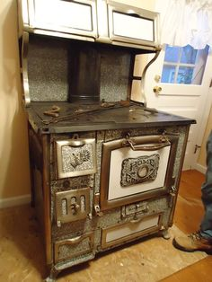 Love these old wood kitchen stoves