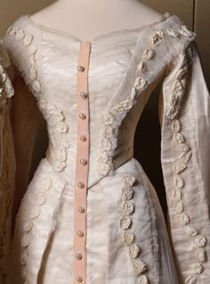 Olga & Tatiana's court dresses on display. Olga's dress is on the right and Tatiana's is on the left. We can see the detail in the lacing of Olga's dress compared to the simplicity of Tatiana's.