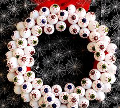 "Add a little bit of Halloween flair to your front door with this easy-to-make ""always watching"" creepy eyeball DIY Halloween wreath. Diy Halloween Ghosts, Halloween Eyeballs, Dollar Store Halloween, Diy Halloween Decorations, Halloween Crafts, Holiday Crafts, Halloween Party, Halloween 2019, Halloween Wreaths"