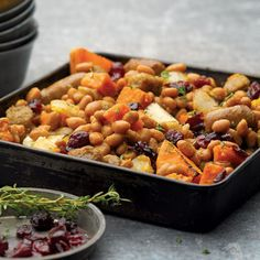 With sweet potatoes, red potatoes, sausages, baked beans, and dried cranberries, this hearty hash has just the right balance of sweet and savory.