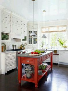 Loving the red island with white cabinets.