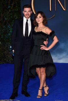 Handsome couple: While Richard looked sharp in a black suit while Jenna wore an unusual fl...