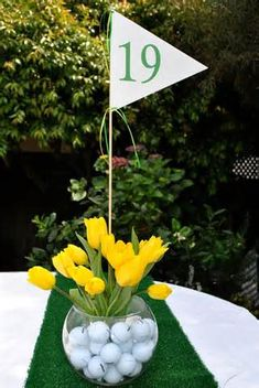 Golf Ball Themed Centerpiece with Yellow Tulips. This is a great idea for a theme party or golf tournament. Thema Golf, Golf Centerpieces, Golf Decorations, Sports Themed Centerpieces, Birthday Centerpieces, Centerpiece Ideas, Graduation Centerpiece, Golf Flag, Golf Wedding