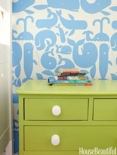 """Little Whales from Walnut Wallpaper is a buoyant backdrop for a dresser Ewart painted so that """"every room has at least a peek of green."""""""