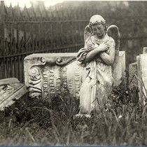 [Statues and gravestones at Laurel Hill Cemetery]