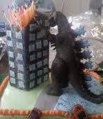 Godzilla birthday cake- good for superheroes party. Would love to see it with the candles lit!