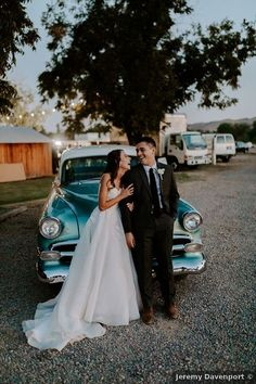 Couple photography in front of vintage blue car, fun wedding picture ideas