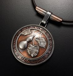 Gourd motif silver and copper round picture pendant by KAZNESQ