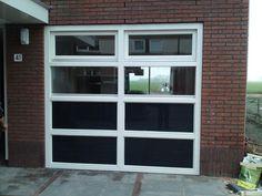 Garagedeur vervangen door glazen pui met toegangsdeur
