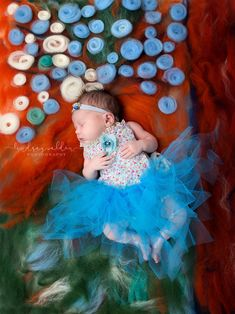 Not long ago I visited an exhibit at a local museum and was inspired to create a series of images incorporating some of the most beloved classic masterpieces into my newborn photography.  I designed the backdrops by hand dyeing raw wool as well as deconstructing coloured yarn. My whole family participated helping me create each design.