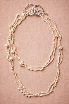 Pearl Atoll Strand Cascading from a hammered silver clasp, variegated pearls form eye-catching clusters and rippling patterns. Handmade by Razok, exclusively for BHLDN. S-hook closure. Bohemian Jewelry, Pearl Jewelry, Wedding Jewelry, Beaded Jewelry, Jewelery, Jewelry Necklaces, Handmade Necklaces, Wedding Accessories, Jewelry Accessories