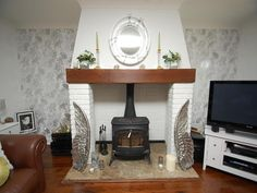 photo of silver white metallic living room lounge with fireplace wood burner wallpaper