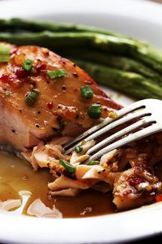 Chili Garlic Glazed Salmon A five star salmon recipe with a delicious sweet chili garlic glaze on top. It caramelizes the salmon as it broils and will become an instant favorite!Sweet Baby Sweet Baby may refer to: Sweet Chilli Salmon, Garlic Salmon, Sweet Chili, Fish Recipes, Seafood Recipes, Dinner Recipes, Cooking Recipes, Diabetic Recipes, Drink Recipes