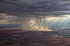 An amazing rainstorm in the distance from the air.