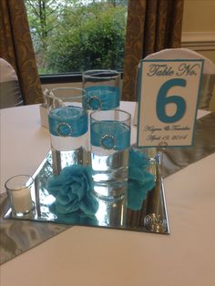 Heavens Touch Wedding Centerpiece - 3 cylinder vases with ribbon and diamond buckle, floating candle. Cylinder Centerpieces, Blue Wedding Centerpieces, Wedding Decorations, Vases, Centerpiece Ideas, July Wedding, Wedding Reception, Dream Wedding, Malibu Blue
