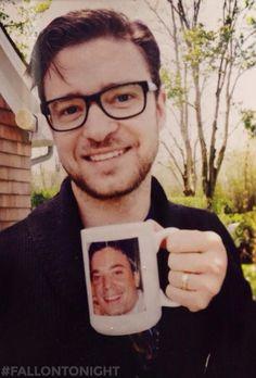 Justin Timberlake holding a Jimmy Fallon mug.