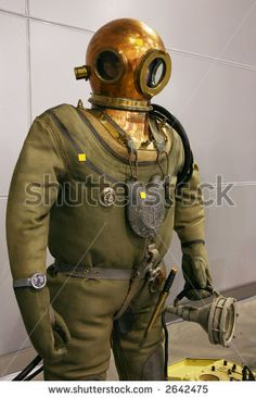 Google Image Result for http://image.shutterstock.com/display_pic_with_logo/59809/59809,1170958175,20/stock-photo-the-mannequin-is-dressed-in-a-diving-suit-with-a-round-copper-helmet-and-in-hands-it-holds-a-2642475.jpg