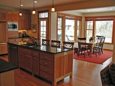An open kitchen that flows into the sunny dining area, makes meals easier & efficient - plan 091D-0017   houseplansandmore.com