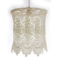 Buy standard shades from target. Cut shade off, leaving metal base. Cover in lace fabric using hot glue.