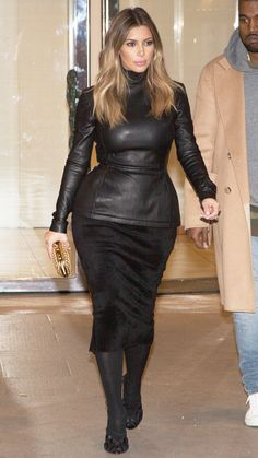 Karashian wore one of her favorite colors, black, head-to-toe while out and about in Paris with fiancé Kanye West.