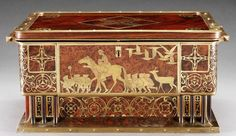 WALNUT BURL WOOD AND BRASS INLAID CASKET BY ERHARD & SÖHNE, EARLY 20TH CENTURY, an inlaid panel to the four sides with scenes from Grimm's fairy tales and stylised floral motifs, the lower corners each with six pilasters  |  SOLD GBP 2,400 Sotheby's Auction, Olympia, June 1, 2005