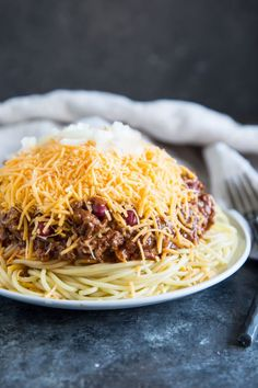 Flavored with unexpected spices, serve this meaty Cincinnati Chili over cooked spaghetti with all classic garnishes: beans, onions, and tons of cheese! Chili Recipes, Meat Recipes, Pasta Recipes, Cooking Recipes, Spaghetti Recipes, Healthy Cooking, Pork Dishes, Pasta Dishes, Chili Con Carne