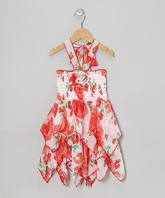 Crafted with soft, sweet chiffon, this blossoming dress boasts a delightful print and large floral embellishment. The cool halter strap in back helps it slip on with convenient ease, while the stretchy shirred bodice ensures a snug fit.