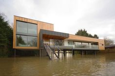 Water, water everywhere...what a way to deal with the terrain. Hind House designed by John  Pardey Architects.