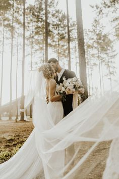Bride, Hannah's veil blowing in the wind. Photo: @alexmari_