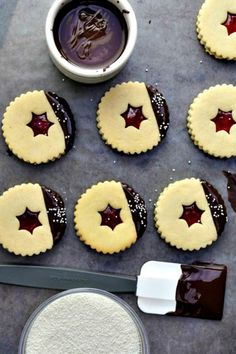 Chocolate-Dipped Linzer Cookies: You didn't think we were going to forget to include a chocolate twist on Linzer cookies, did you? Enjoy these chocolate dipped linzer cookies as Christmas dessert. Christmas Sweets Recipes, Best Christmas Cookies, Holiday Cookie Recipes, Easy Cookie Recipes, Holiday Cookies, Christmas Desserts, Christmas Baking, Holiday Baking, Dessert Recipes