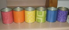 new marker caddies for my classroom...old cans, scrapbook papers and some mod padge and wallah.... #modpodge #cans #ecoart #upcycle #art #diy #craft #rainbow