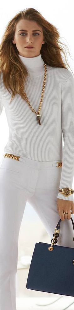 White high neck sweater with white pants and handbag