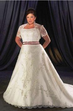 Tulle and Satin wedding gown features illusion cap sleeves with a sweetheart neckline and satin band at the natural waist. The a-line skirt is at floor length with a chapel length train. Suggested Retail Price: $ 1439.95 Our Price $399.99