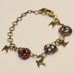 Wire wrapped bird nest bracelet with freshwater pearl beads and Vintaj bird charms.