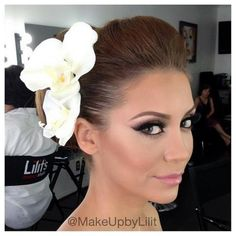 glamorous bridal makeup without it being too much. And I really like the hair..