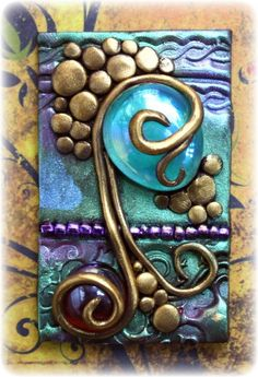 Polymer clay tile I made using clay, glass beads and mica powder ~ Gabrielle