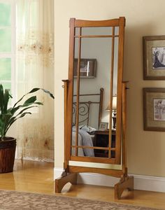 """Warm oak finish wood mission style free standing cheval bedroom dressing mirror . Measures 25"""" x 16"""" x 65"""" H. Some assembly required."""