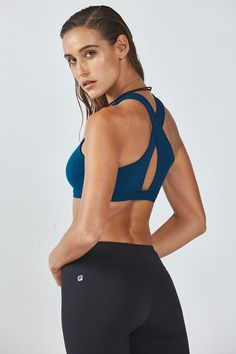 peacock color. Catch some air in our medium-support bra with breathable, keyhole details. When things heat up, its moisture-wicking fabric will keep you cool.