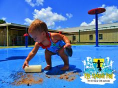 I am sure she is building the biggest mud pie in the world in her mind on this splash pad.  A daycare splash pad is great fun, exercise for their bodies and their minds, oh and the teachers love it too!