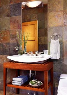 Love this for the bathroom. The tile walls make it feel warm and inviting. The sink is great too!