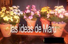 """Macetas de barro natural con flores artificiales """"violetas"""""""
