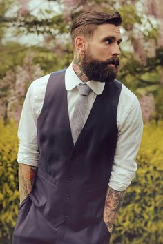 Haircut, beard groomin', blue grey suit, just a vest no jacket...hey look even shrunk up ear holes!