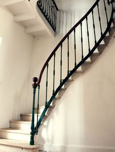 A fairy tale–worthy winding staircase at the vacation home. | Lonny.com