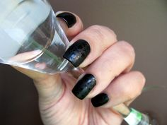 Smirnoff Vodka-inspired nail art using Wet N Wild Black Creme, Seche Vite top coat, NYC matte top coat and Vivid Lacquer plate 001. Technique: Coat nails in black nail polish; apply matte topcoat.  When polish is dry, stamp the skulls on nails with the clear topcoat. #Smirnoff #nailart #nailtrends #nailpolish #manicure #girlsnight #notd http://www.etsy.com/shop/VividLacquer