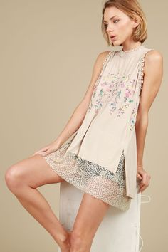 Smocked mock neck sleeveless top with floral embroidery and laced front bottom contrast  25%off code: DREAMBIG