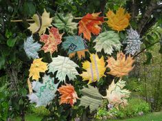Acer leaves sewn from assorted fabrics and lightly padded.