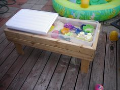 Here's mine: Sand box I made for $13, and hubby built the stand with old wood that was going to thrown out by his brother.... ;)