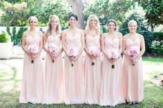 Blush bridesmaids dresses. Not these dresses but maybe having different dresses in the same color or even different hues of blush