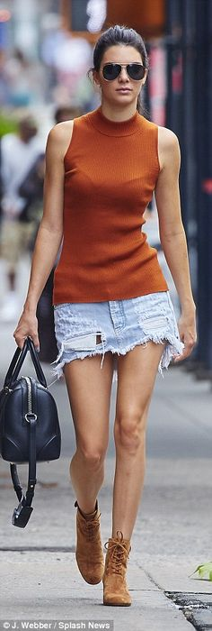 ab539dbecf Kendall Jenner flashes long legs in frayed jean skirt