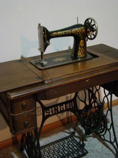 Treadle Singer Sewing Machine...classic.....just like my Grandmother's :) She bought her's in 1924 and I now own it and would love to restore it!